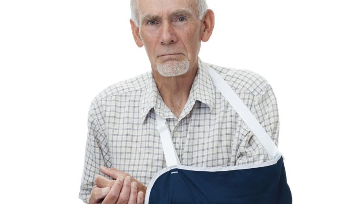 elderly man wearing sling