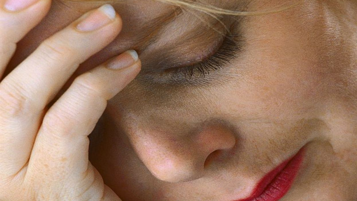 woman face showing signs of stress and worry