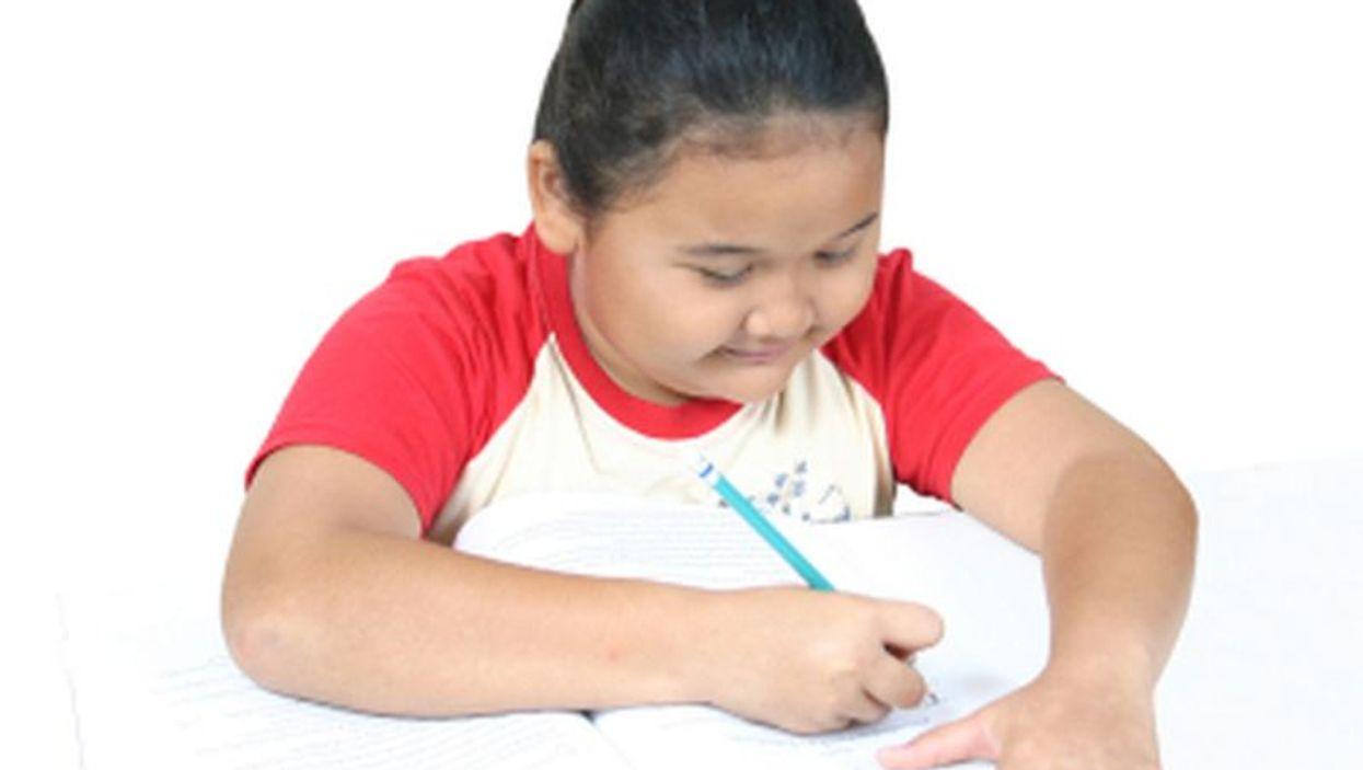 fat child writing something
