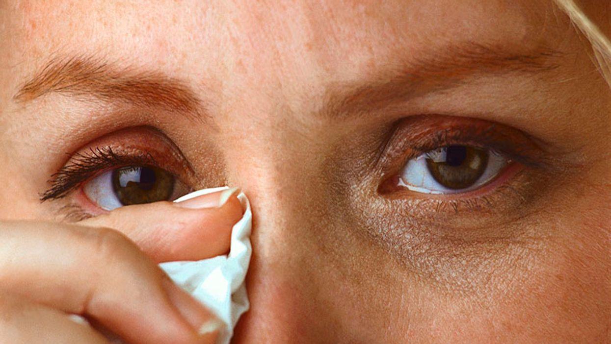 woman wiping tears