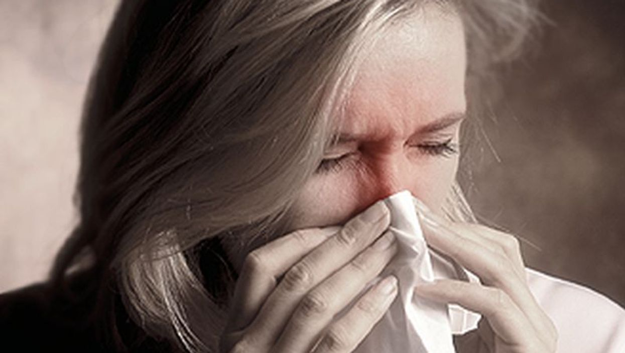 woman blowing nose