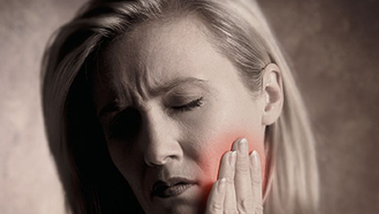 woman with cheek pain