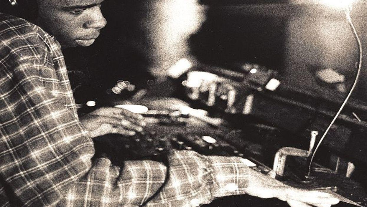 man DJ behind console