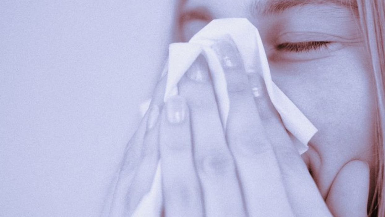 sneezing into tissue