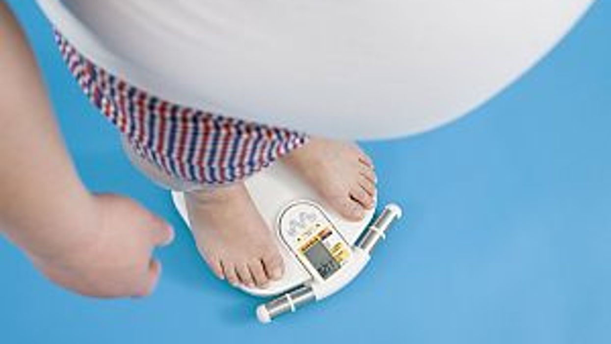 obese man weighs himself