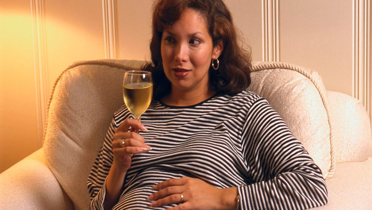 pregnant woman drinking wine