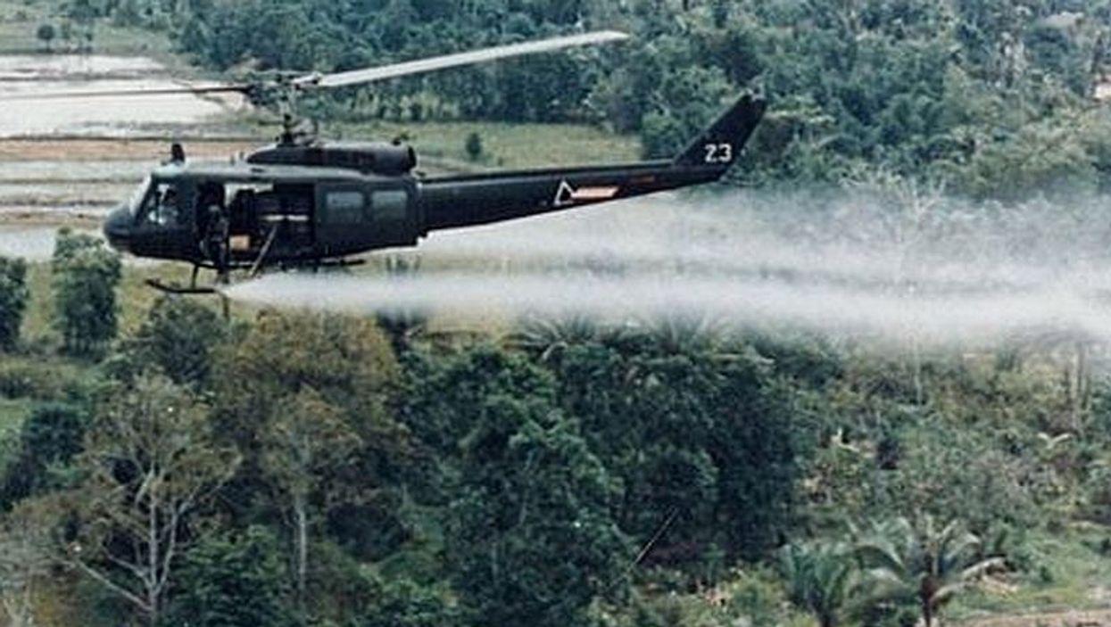 U.S. helicopter spraying agent orange during Vietnam War