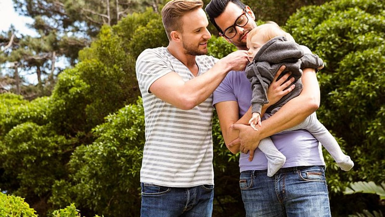 male couple and child