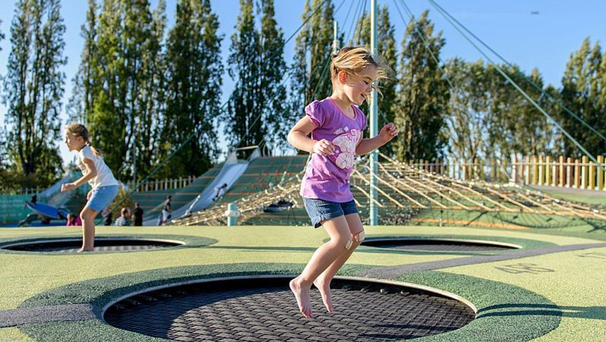 girls on playground trampolines