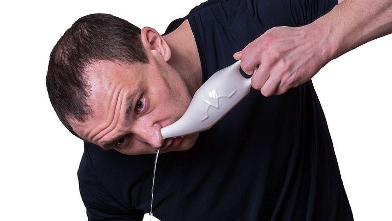 man using neti pot