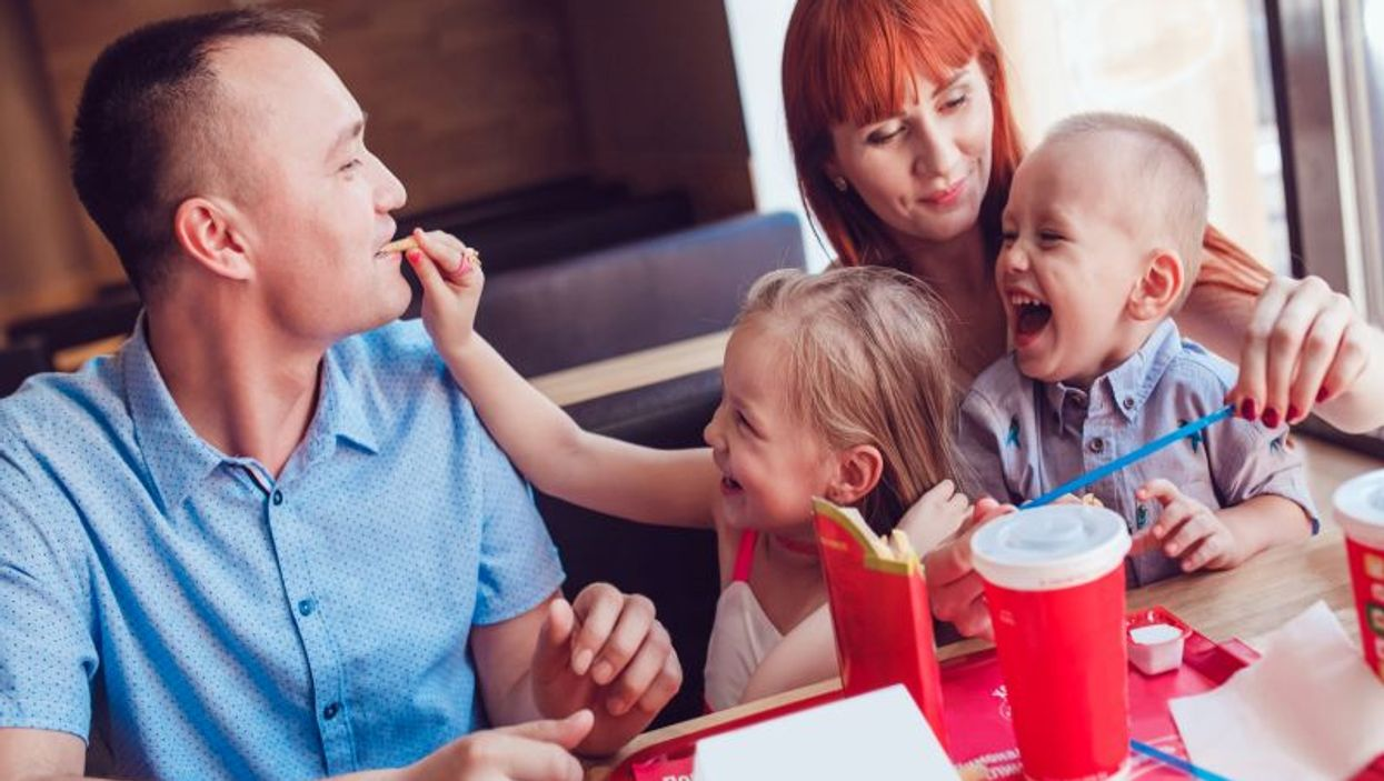 family at fast food restaurant