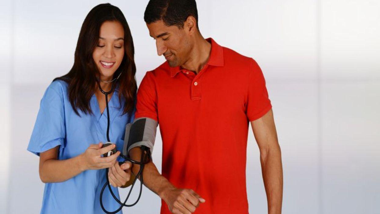 hispanic man getting blood pressure checked