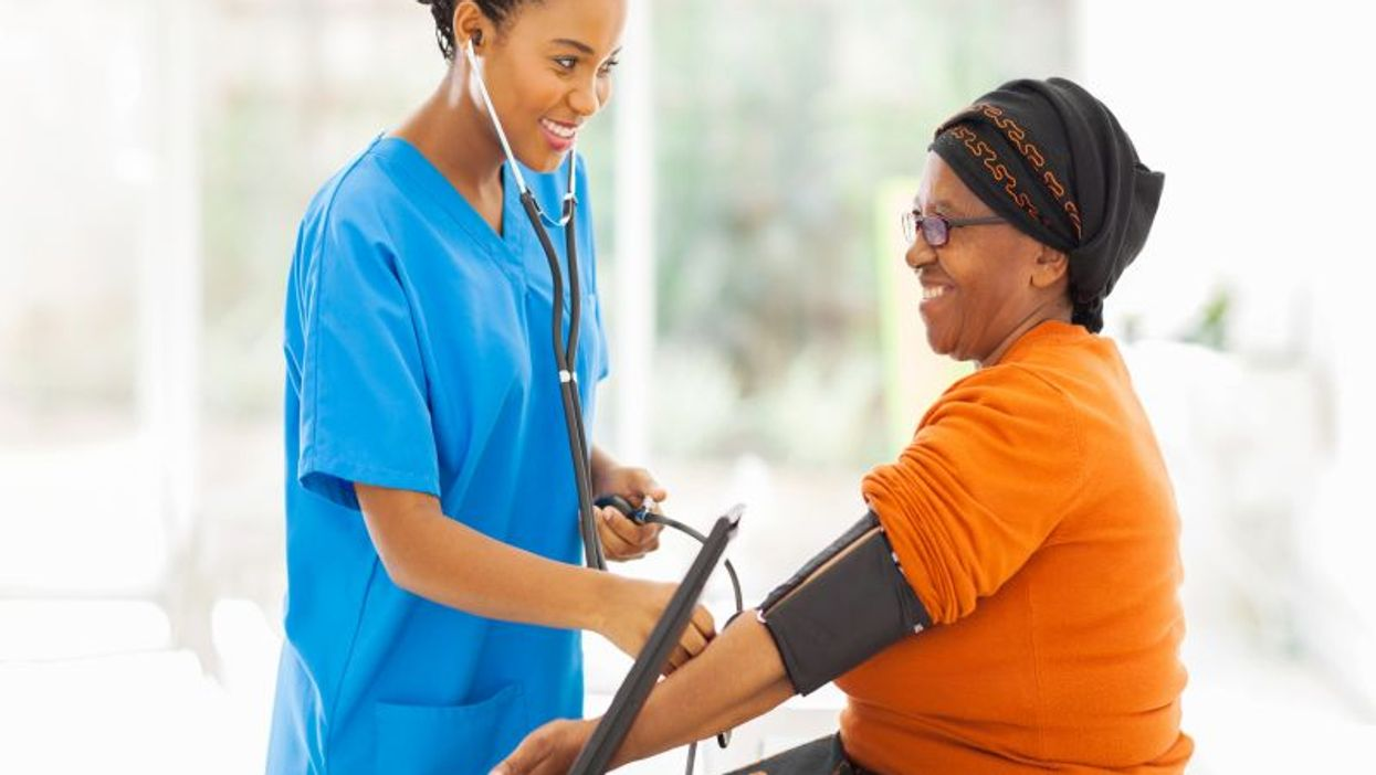 African american woman getting blood pressure checked