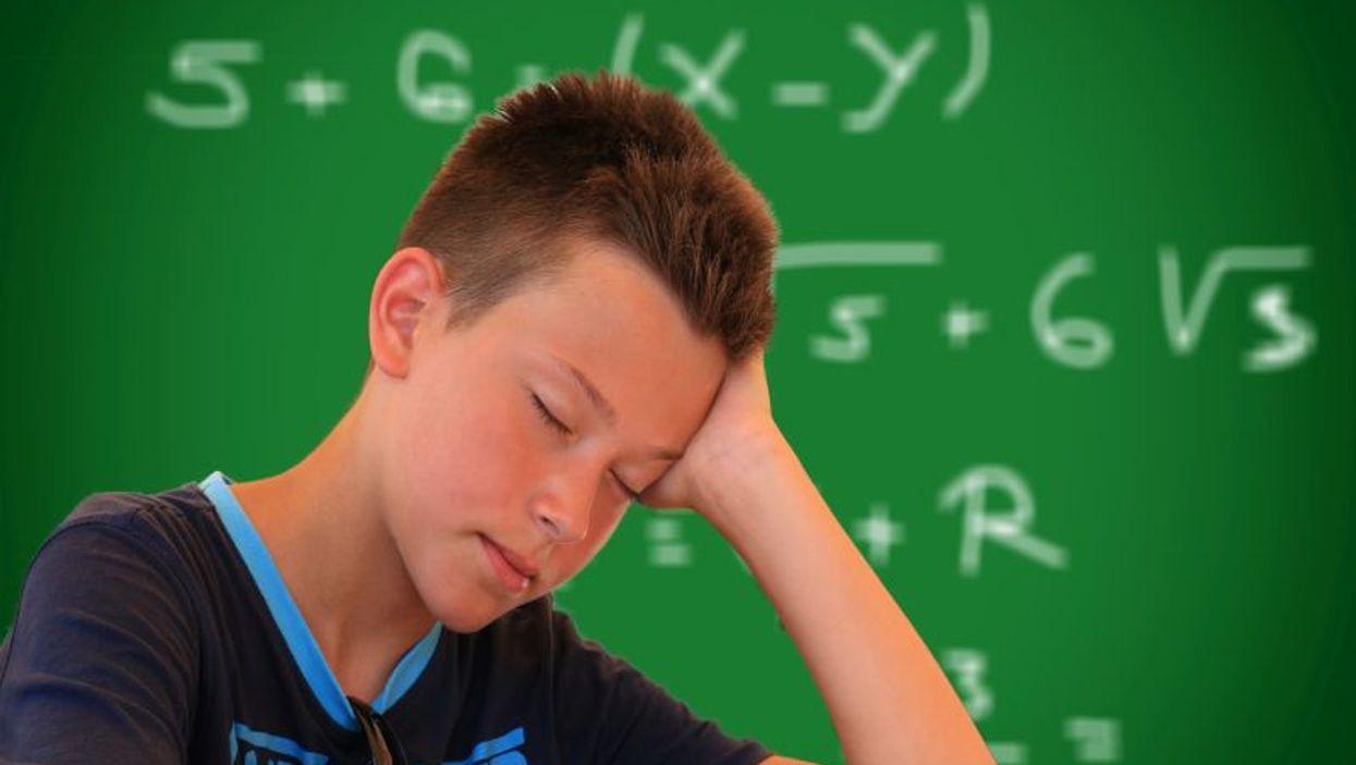 sleepy teen in school