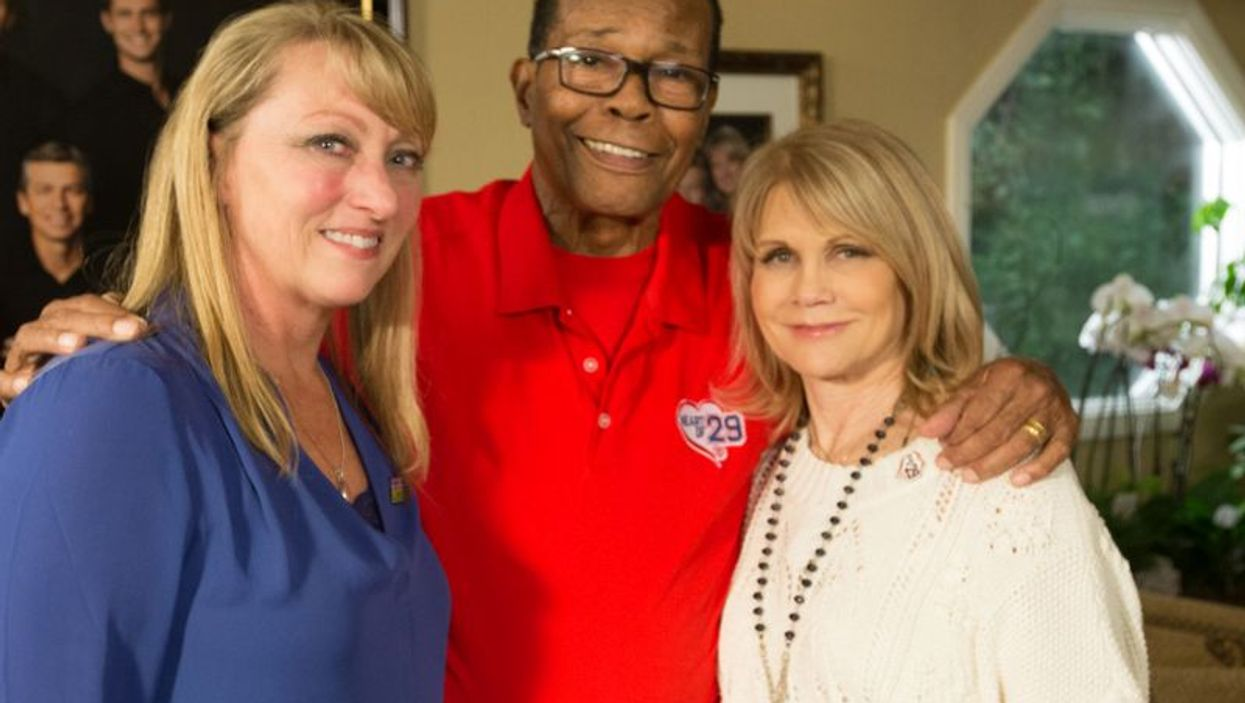 Mary Reuland (left), with Rod and Rhonda Carew (right)