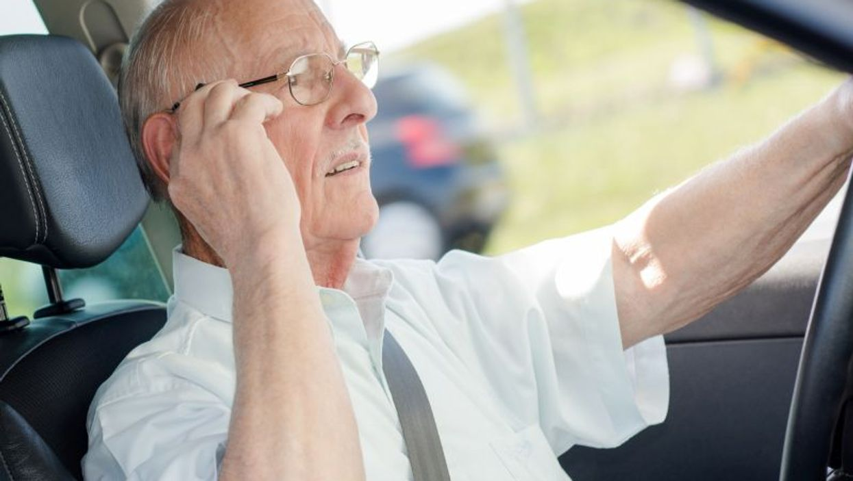 elderly driver on cell phone