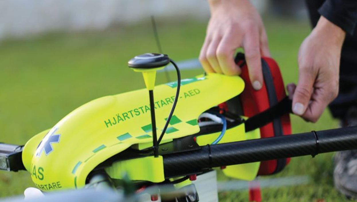 Bystander unloading AED from drone