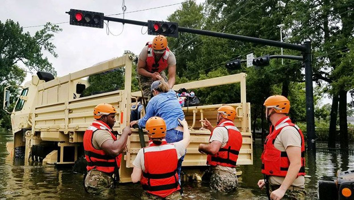 Texas National Guardsmen assist residents affected by flooding caused by Hurricane Harvey