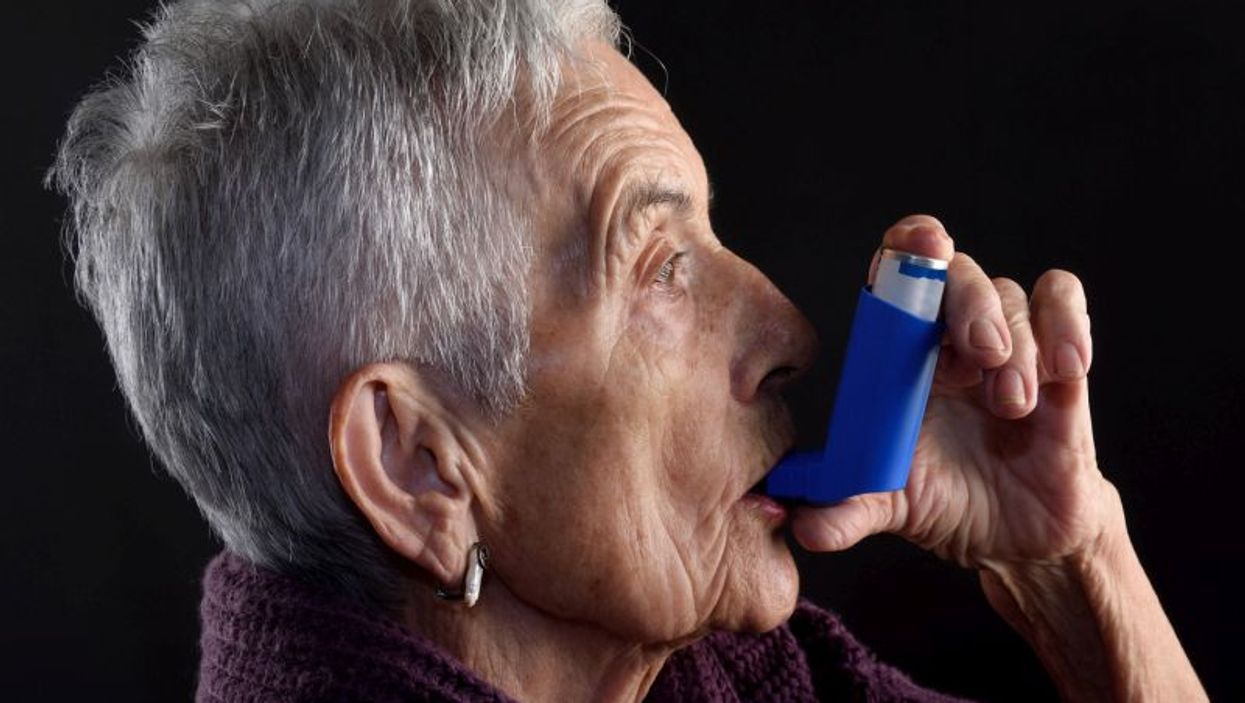 elderly woman with inhaler