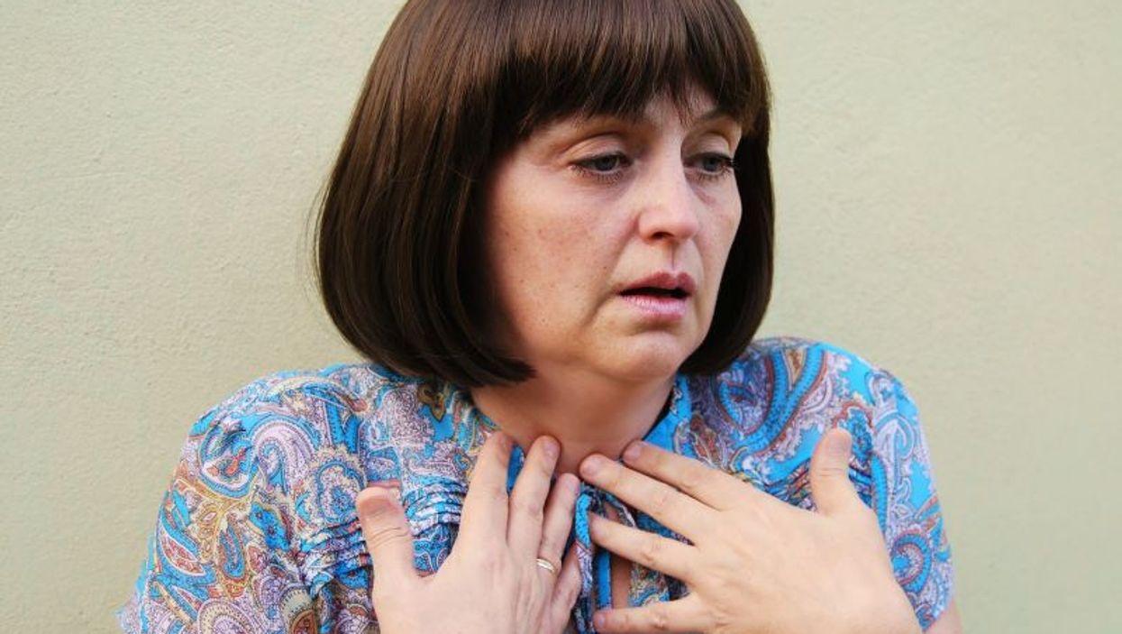 woman wheezing