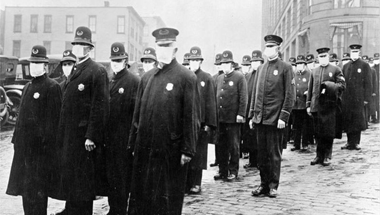 Policemen in Seattle wearing masks during the 1918 influenza epidemic.