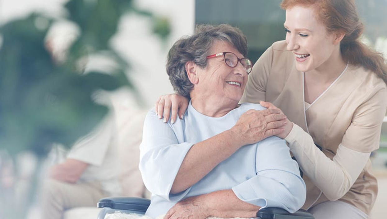 younger woman caring for elderly woman