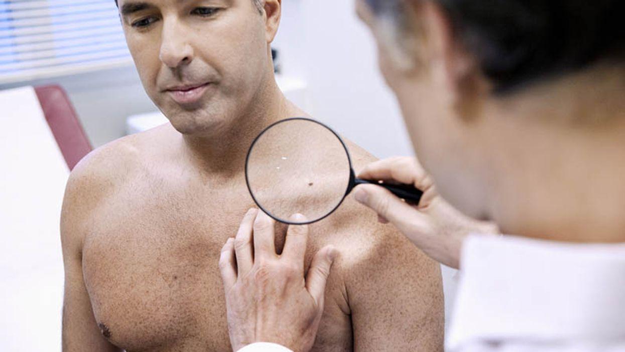 doctor examining patient\'s skin