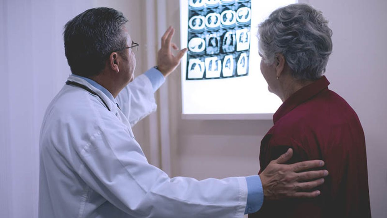 doctor and patient discussing cancer xray