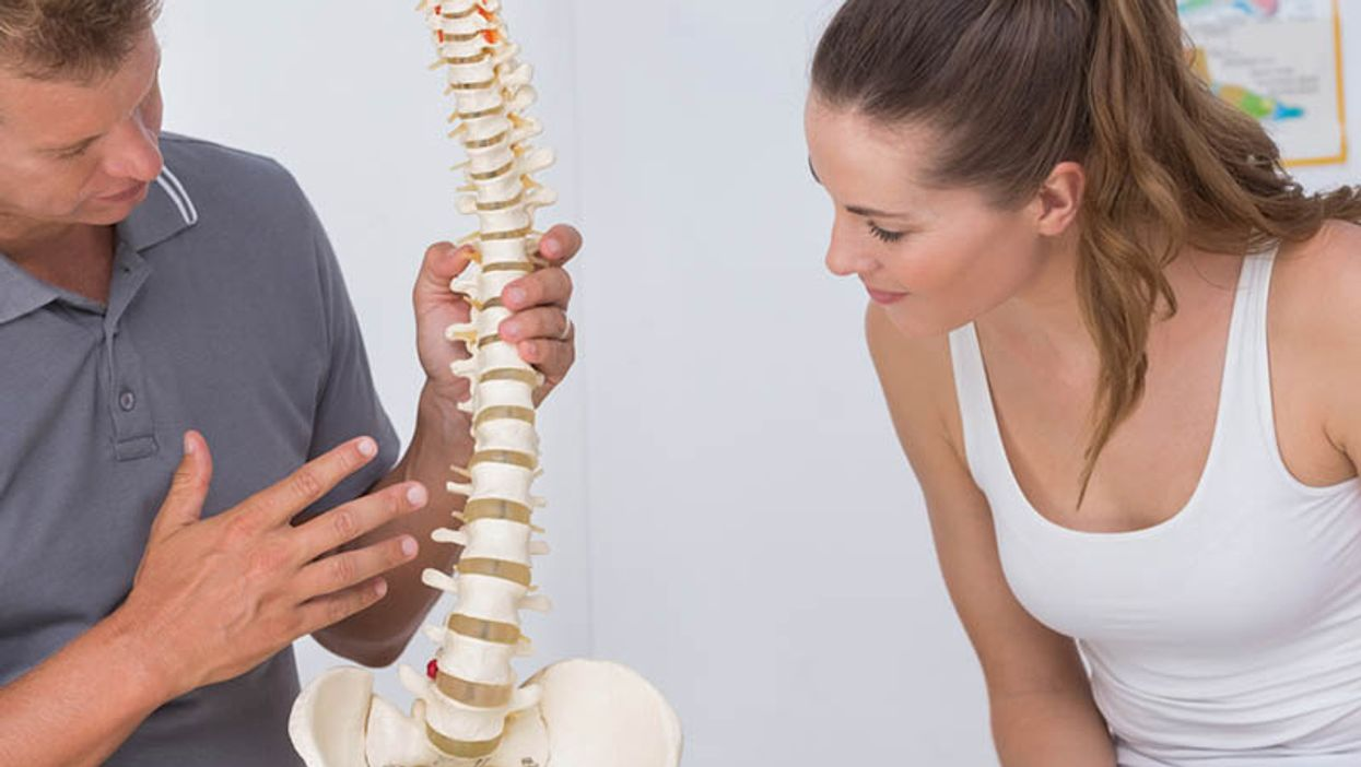 patient looking at model spine