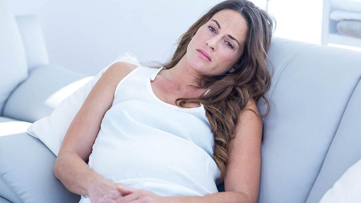 pregnant woman looking sad