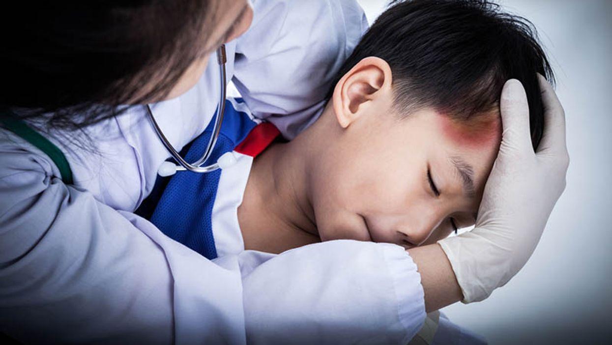 a boy with a head injury