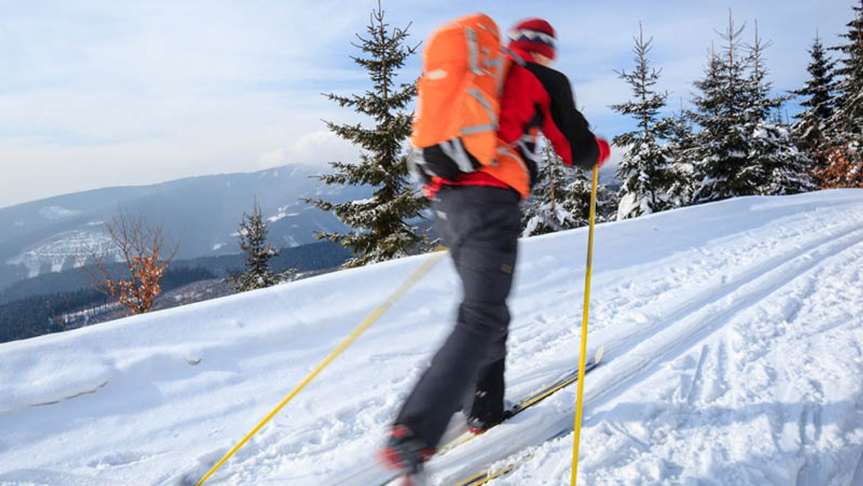 man ski walking in the winter outdoors