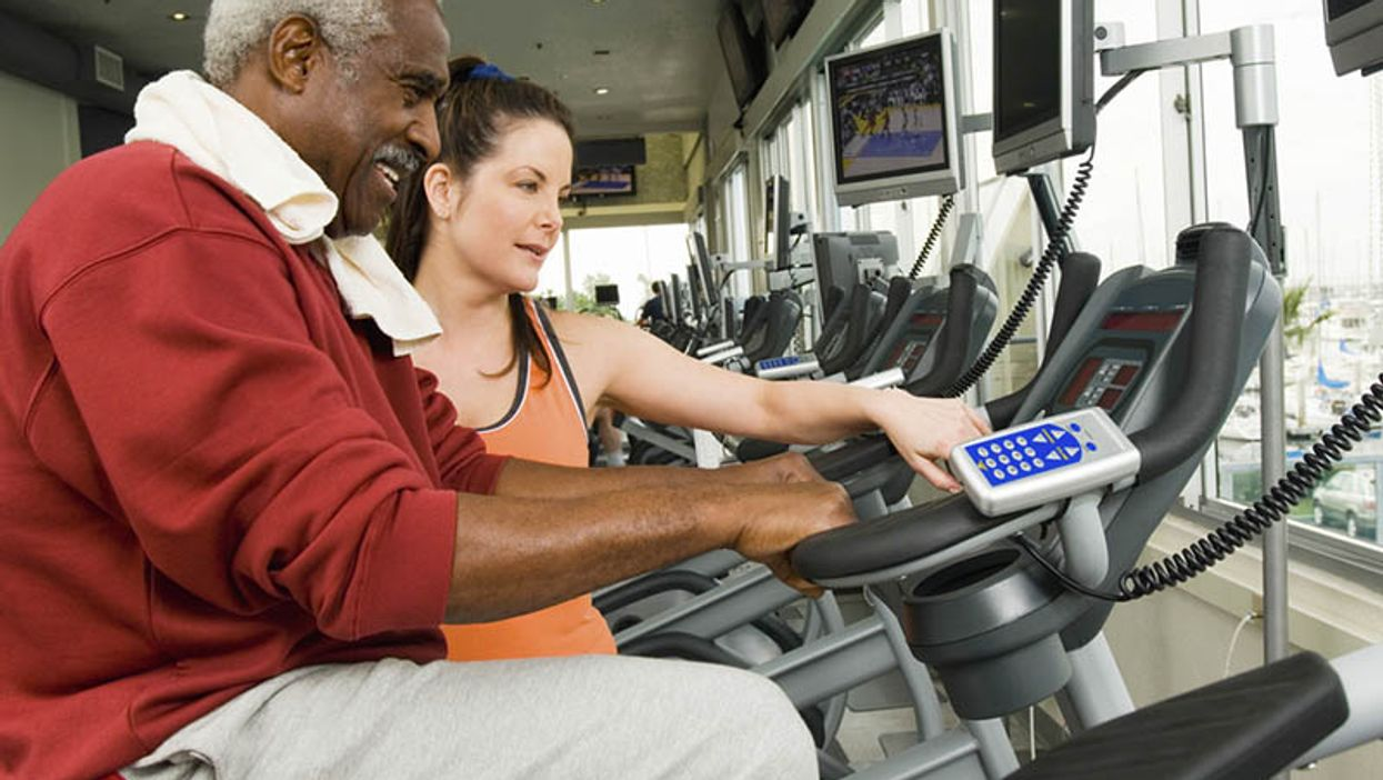 people in the gym on the exercise machines