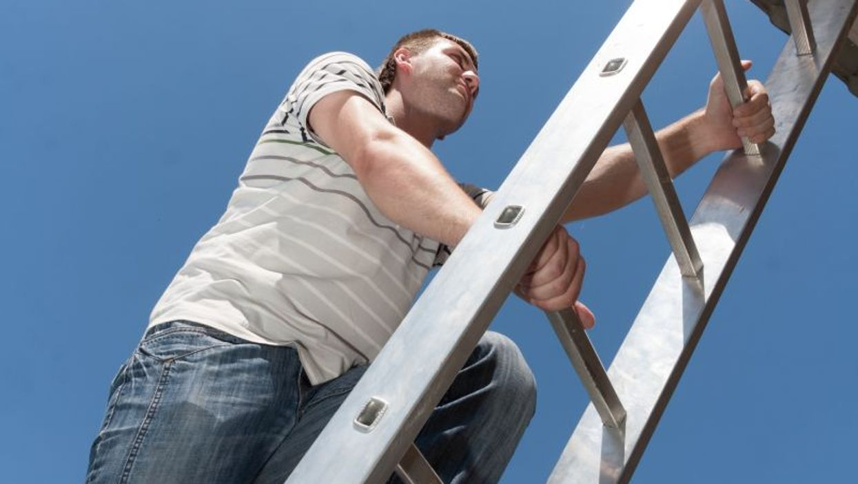 man climbing a ladder