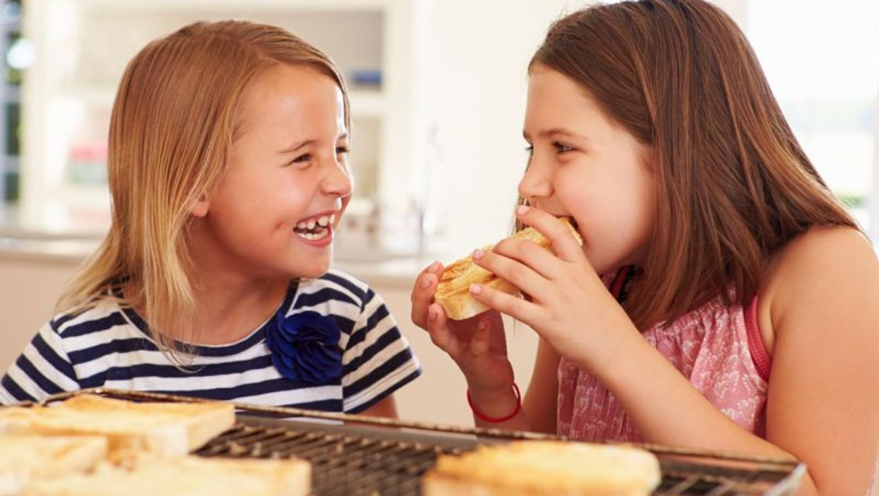 young girls eating bread