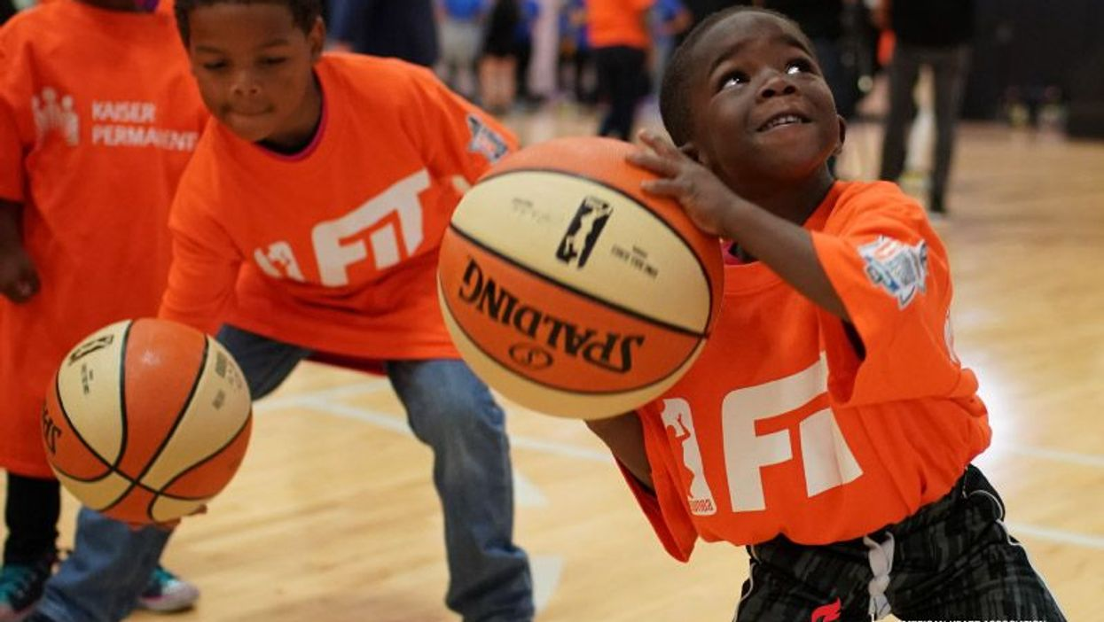Kids practice at one of the WNBA\'s FIT Clinics.