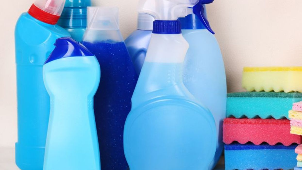 household cleaners on kitchen shelf