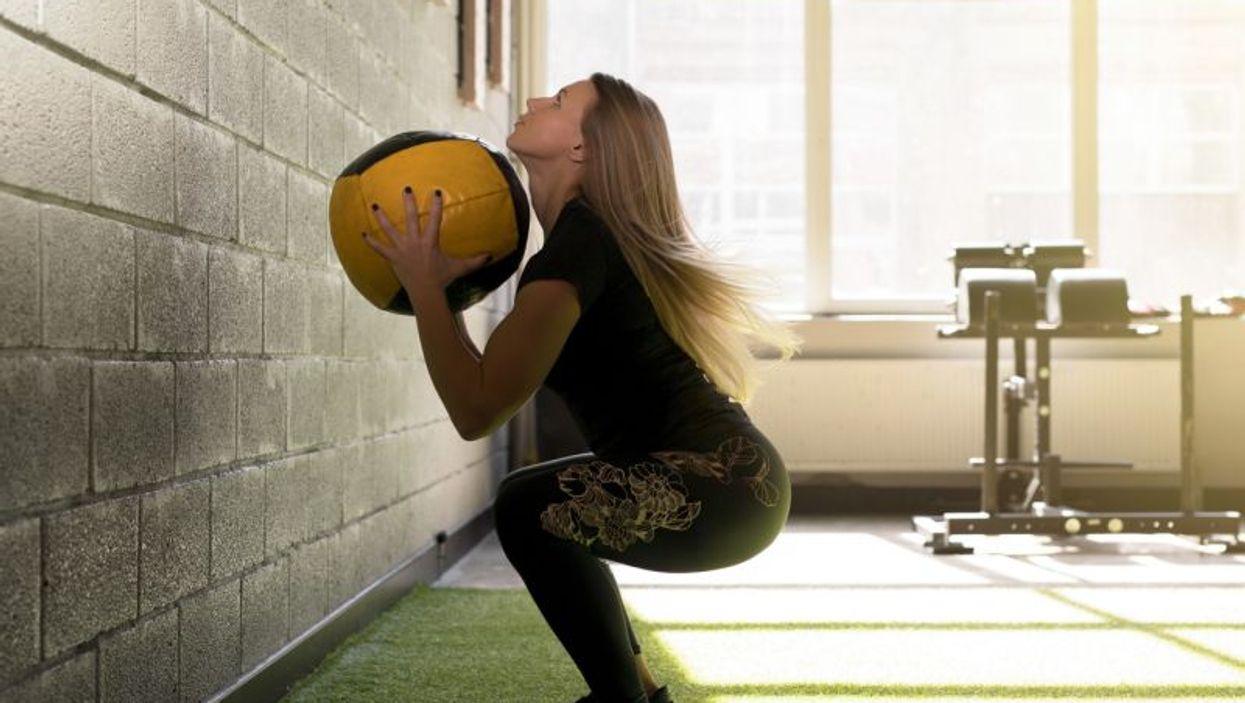 woman using medicine ball