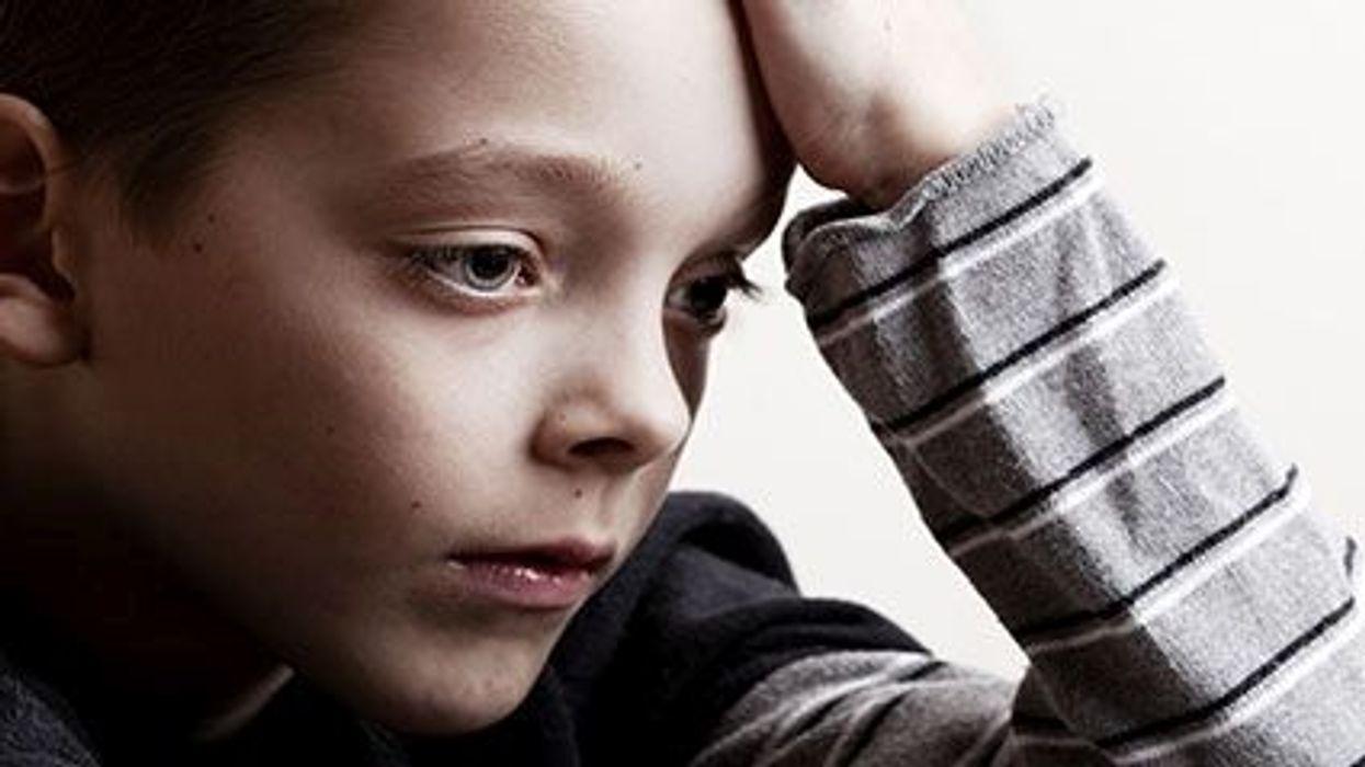 a sad boy\'s face close up