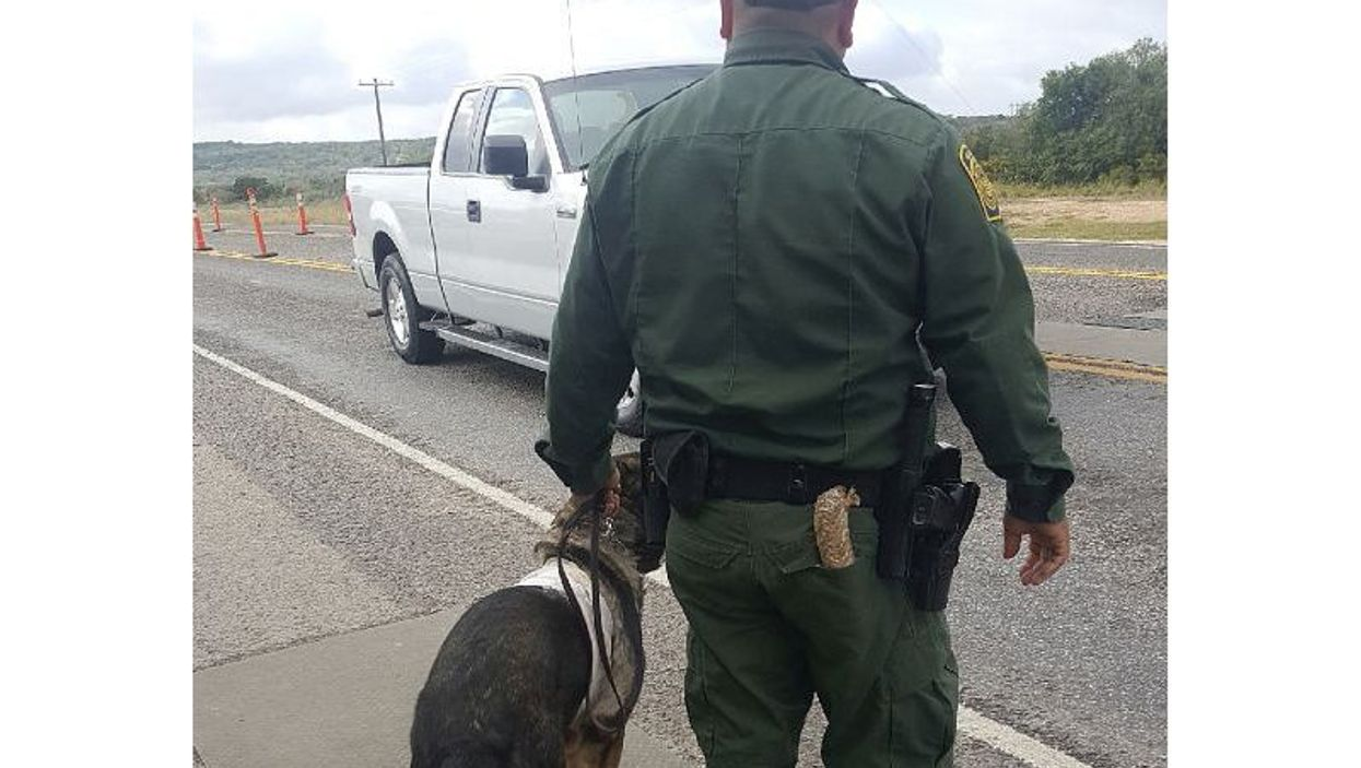 Border patrol agent and dog