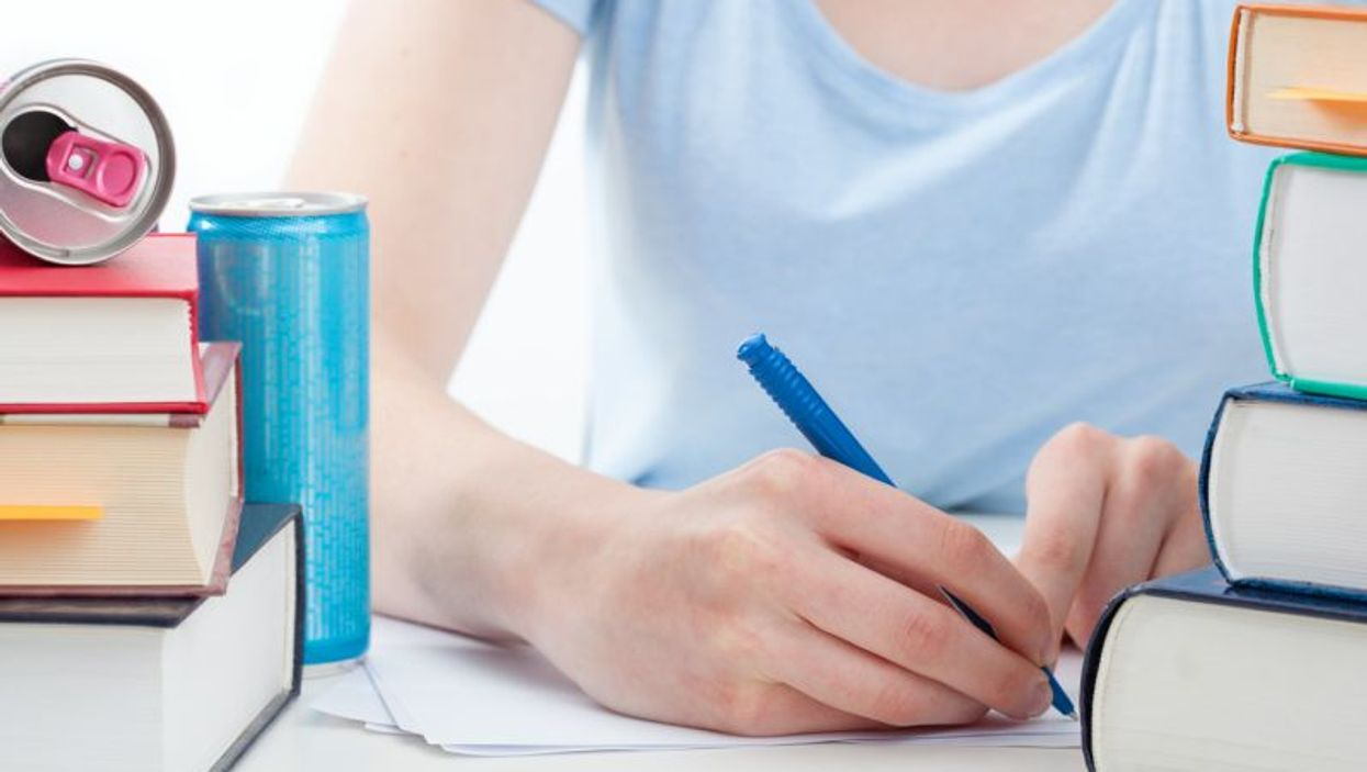 Girl studying while consuming energy drink