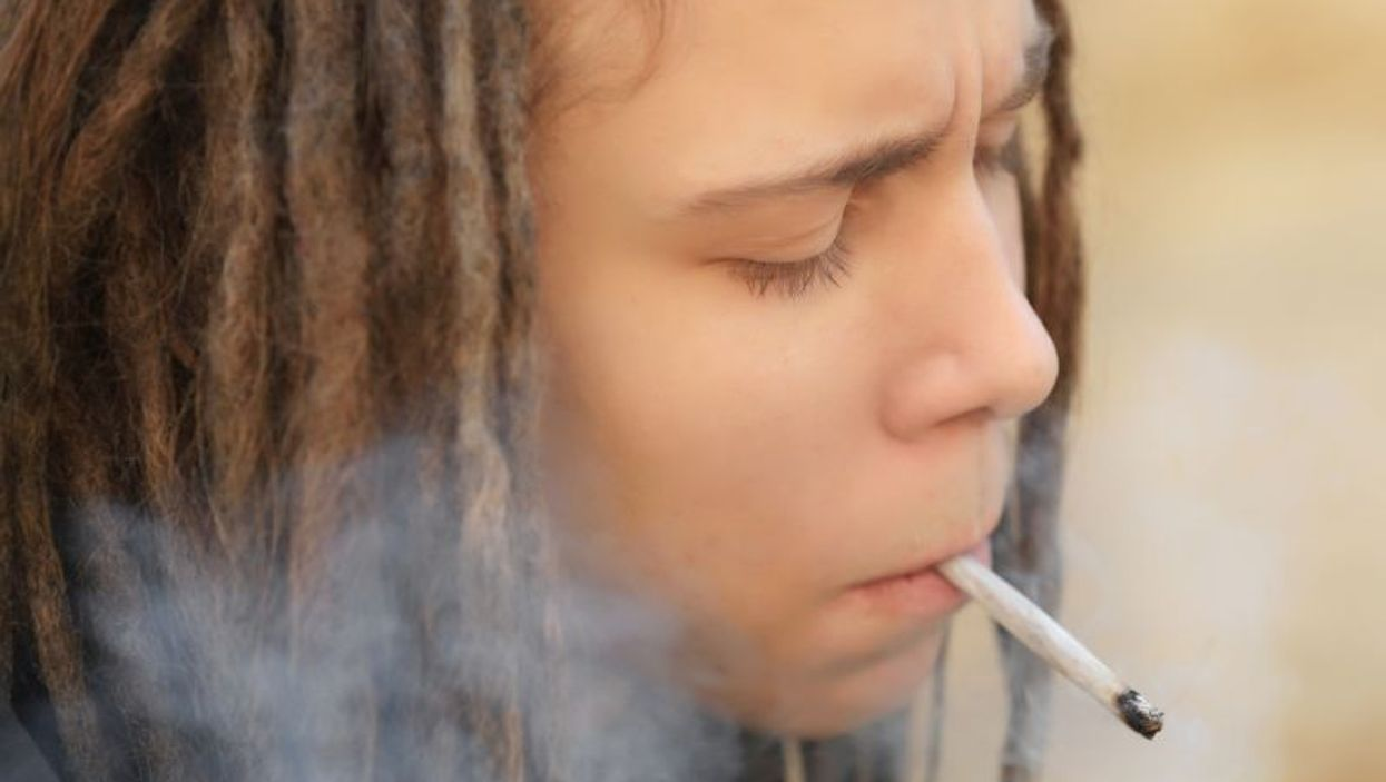 teen boy smoking marijuana