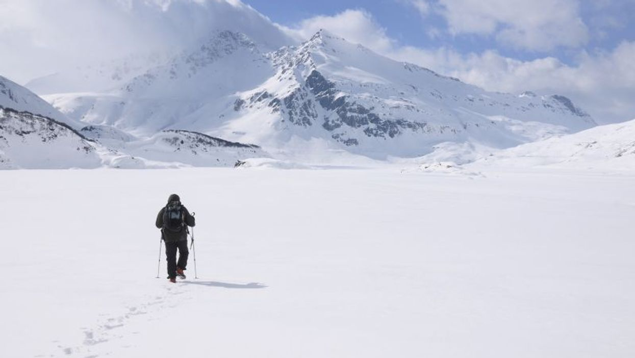 Arctic snowy landscape with a person in parka