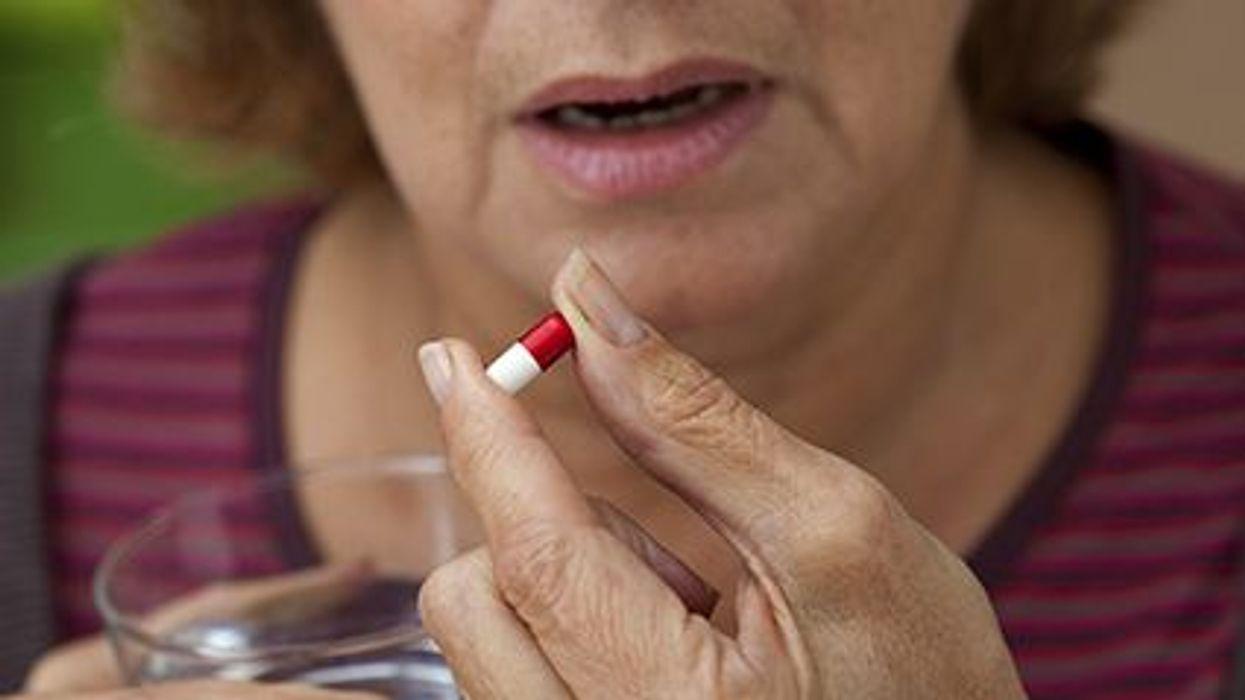 a woman taking pill