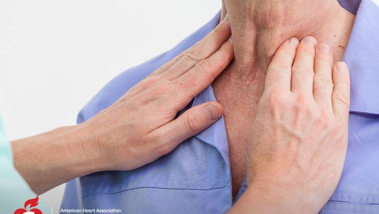 a person checking his thyroid
