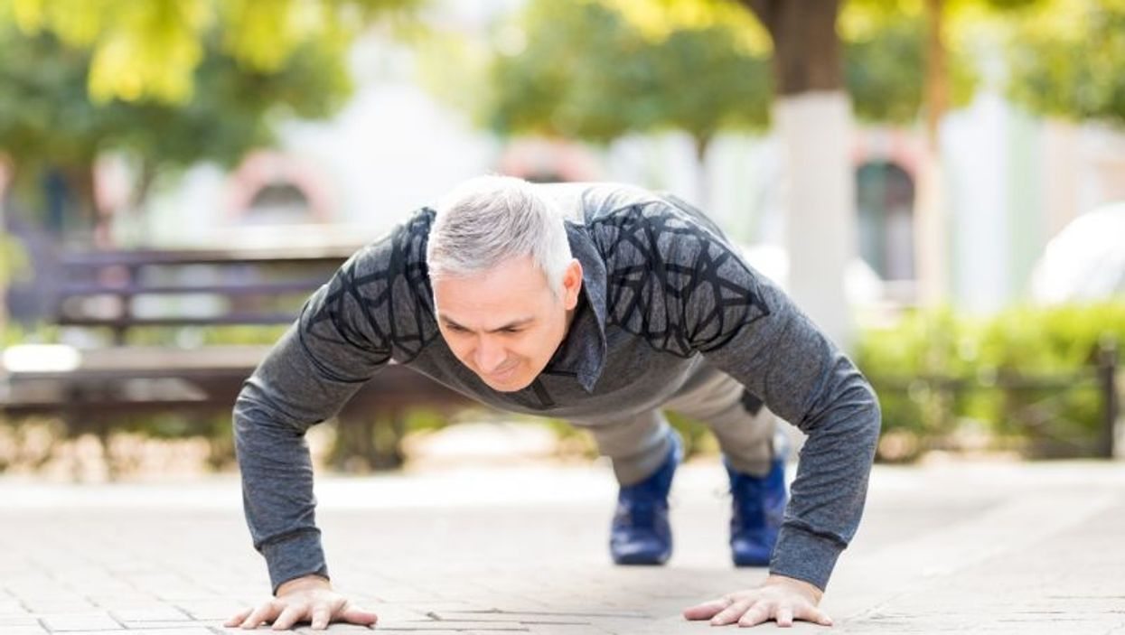 middle-aged man doing pushup