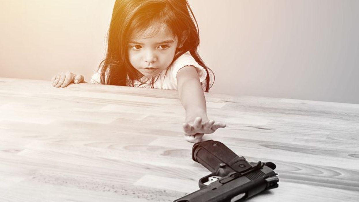 child and handgun