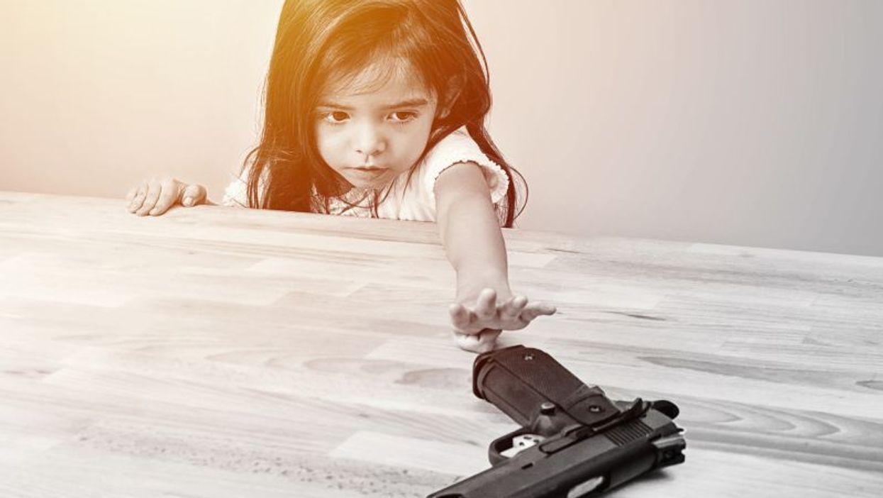 child and handgun