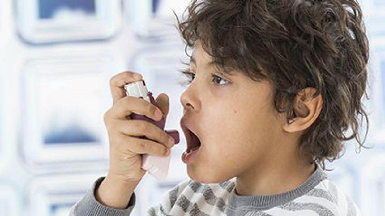 a kid with a inhaler