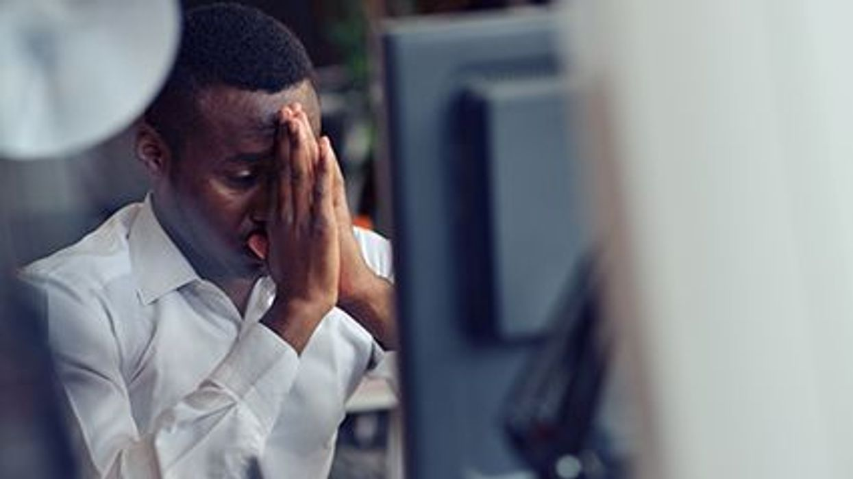 a man stressed in front of the computer